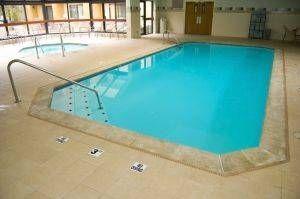 Hvordan ta vare på en In-Ground svømmebasseng