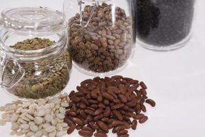 Har Bean frø vokse bedre i jord, vann eller et vått papirhåndkle?