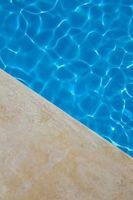 Hvordan Flekk Betong Rundt svømmebasseng