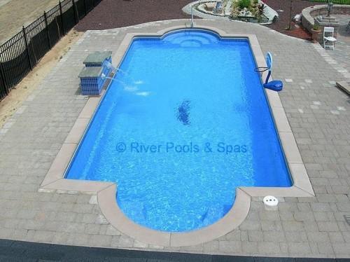 Hvor mye koster en glassfiber svømmebasseng Cost?