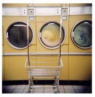 Hva er forskjellen mellom flytende vaskemiddel & Pulverisert vaskemiddel?